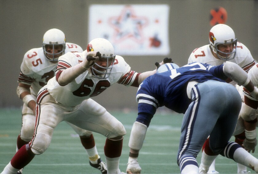 ST. LOUIS, MO - CIRCA 1972: Conrad Dobler #66 of the St. Louis Cardinals in action against Jethro Pugh #75 of the Dallas Cowboys during an NFL football game at Busch Stadium circa 1972 in St. Louis, Missouri. Dobler played for the Cardinals from 1972-77. (Photo by Focus on Sport/Getty Images) ** TCN OUT **