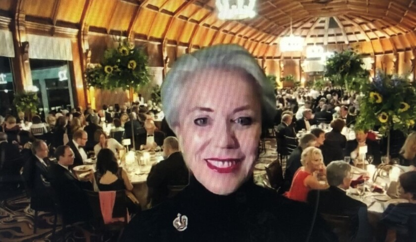 With a photo of a past Charity Ball behind her, Ellen Moxham emceed the online 2021 gala reception on Feb. 26.