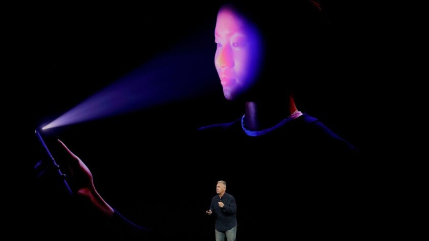 Apple executive Phil Schiller announces the Face ID feature in September.