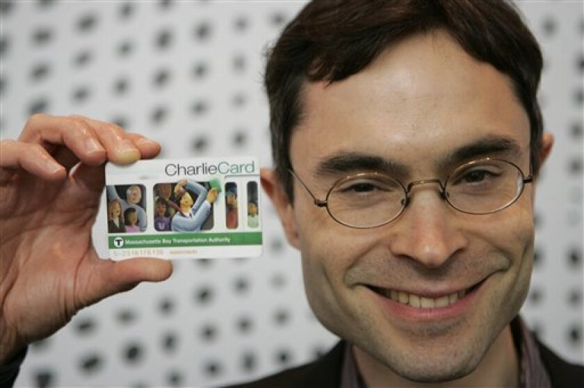 In this, April 22, 2009 photo, Ari Juels, chief scientist and director for RSA Laboratories, holds a Massachusetts public transportation card with an RFID (radio frequency identification) security chip imbedded in it at the RSA Security Conference in San Francisco. (AP Photo/Marcio Jose Sanchez)