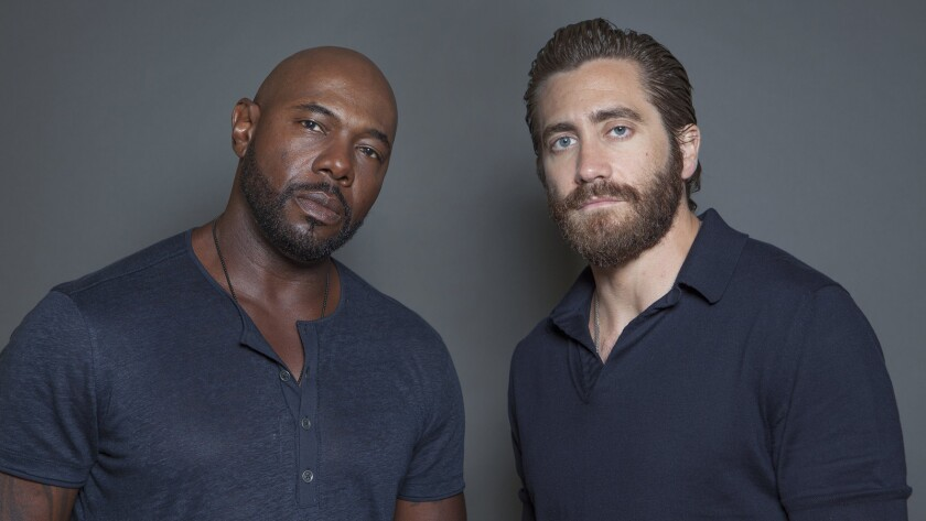 Antoine Fuqua, left, and Jake Gyllenhaal pose for a portrait at the Four Seasons Hotel in Los Angeles.