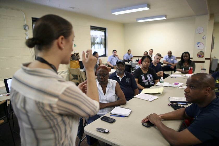 In this Saturday, July 9, 2016 photo, Dr. Zoe Maher, a Temple trauma surgeon, explains the Philadelphia Immediate Transport in Penetrating Trauma Trial (PIPT) to community leaders, at the Hunting Park Community Center, in Philadelphia. The difference between being a gunshot survivor or a homicide v