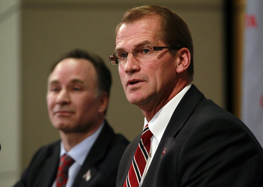 SDSU president Elliot Hirshman (left) and athletic director Jim Sterk must wait for the NCAA to decide whether to launch a formal investigation into its men's basketball program.