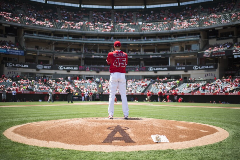 Tyler Skaggs prepares to pitch while warming up for the Angels before a game against the Red Sox on July 31, 2016.
