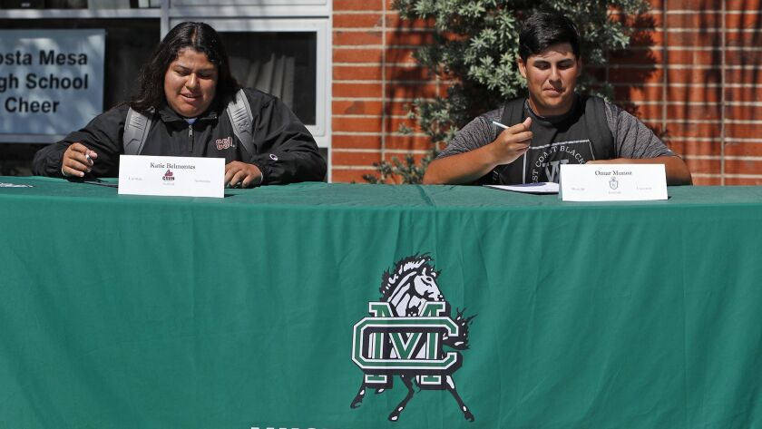 Softball player Katie Belmontes and baseball player Omar Munoz participate in a National Signing Day