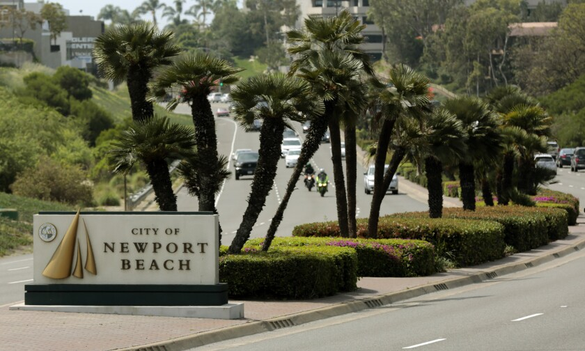 A sign on Newport Boulevard at Industrial Way welcomes visitors to Newport Beach.