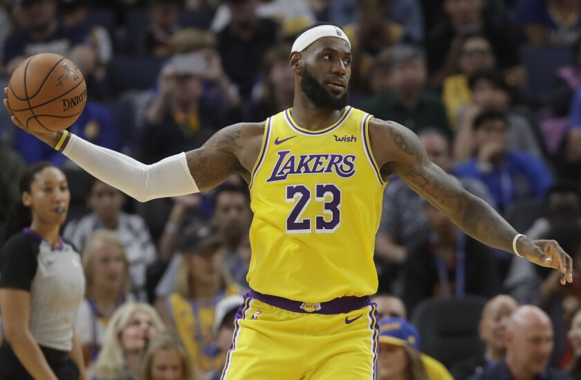Lakers forward LeBron James says he had felt a little nervous before Saturday's exhibition opener against the Golden State Warriors. But the Lakers won, 123-101, and he emerged uninjured.