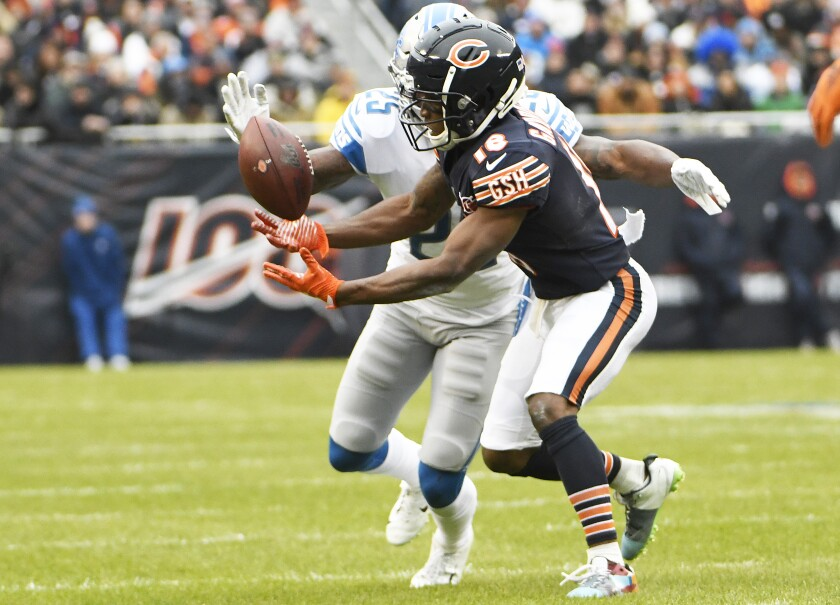 Chicago Bears wide receiver Taylor Gabriel tries to make a catch in front of Detroit Lions safety Will Harris.