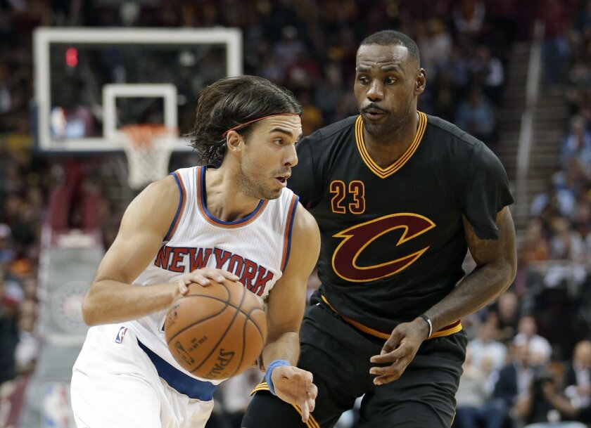 New York Knicks' Sasha Vujacic (18),from Slovenia, drives against Cleveland Cavaliers' LeBron James (23) during the first half of an NBA basketball game Wednesday, Nov. 4, 2015, in Cleveland. (AP Photo/Tony Dejak)