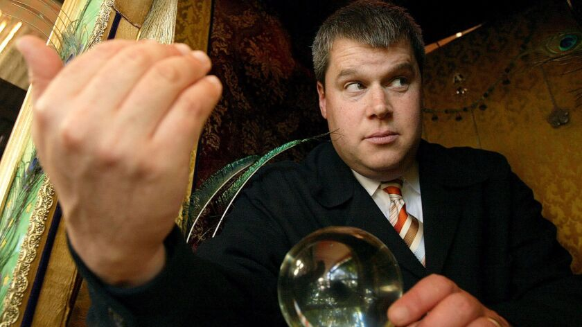 """Daniel Handler in a card reader booth at Cafe Flore in San Francisco; his new novel is """"All the Dirty Parts."""""""