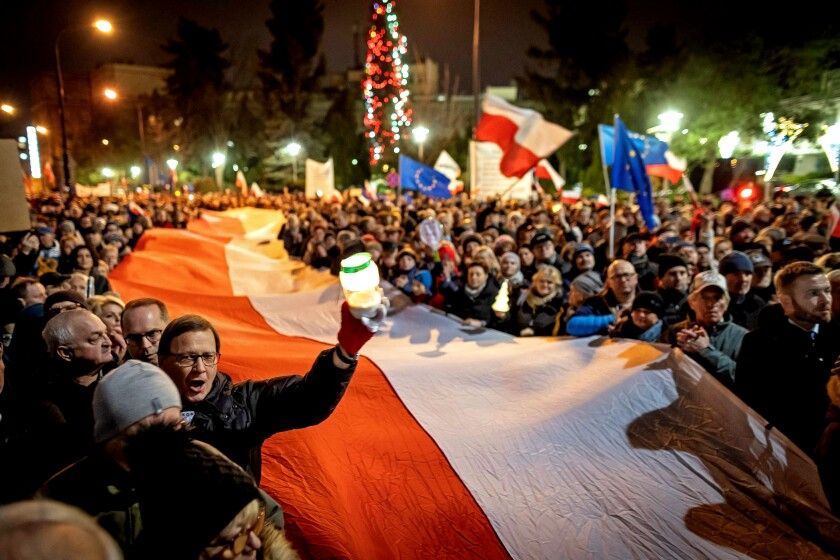 Polish protesters with a giant national flag