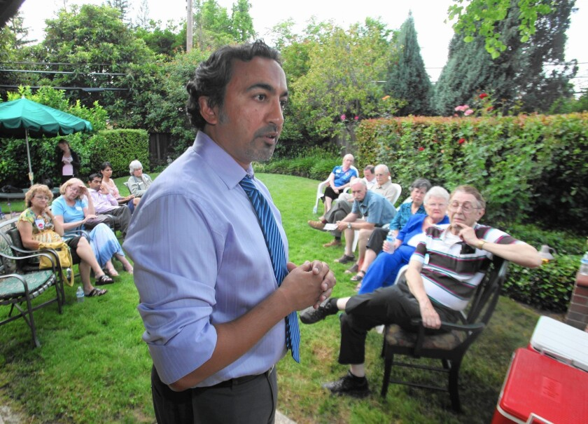 Democrat Ami Bera, talking with supporters in 2010, narrowly won this year's race for his California Congressional seat. Despite millions spent on each candidate's campaign, many people voted along party lines.