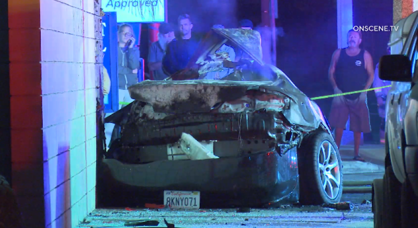 A driver died after crashing into an Army-Navy surplus store in Newport Beach on Sunday night.