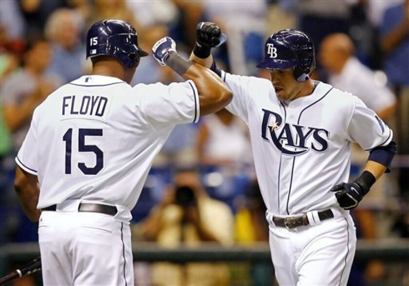 Tampa Bay Rays' Evan Longoria, right, is congratulated on his solo home run in the sixth inning of a baseball game against the Chicago Cubs by teammate Cliff Floyd who hit his own solo home run in the second inning Tuesday, June 17, 2008, in St. Petersburg, Fla. (AP Photo/Mike Carlson)