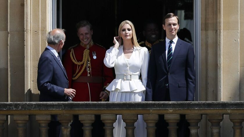 Jared Kushner, right, and Ivanka Trump, second right, watch from a window before a ceremonial welcom