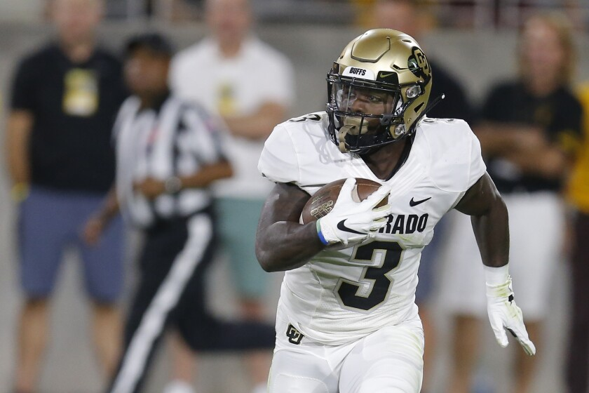 Colorado wide receiver K.D. Nixon carries the ball in a game against Arizona State.