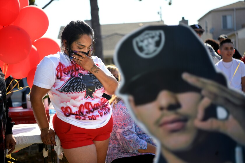 Leah Garcia cries for her late son, Paul Rea, during a vigil in Los Angeles.
