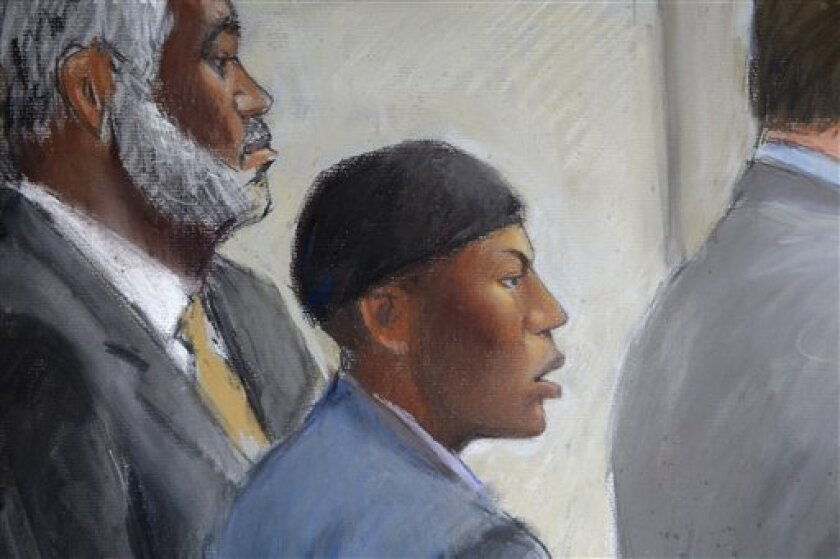 FILE - In this Oct. 12, 2011 file courtroom drawing, Umar Farouk Abdulmutallab, center, appears in U.S. District Judge Nancy Edmunds' courtroom in Detroit with Anthony Chambers, his lawyer who was assisting in his defense, left, and Assistant U.S. Attorney Jonathan Tukel, right. The sentencing for Abdulmutallab, who admits he tried to blow up a Detroit-bound airliner has been postponed. He will now get his mandatory life sentence on Feb. 16. (AP Photo/Jerry Lemenu, File)