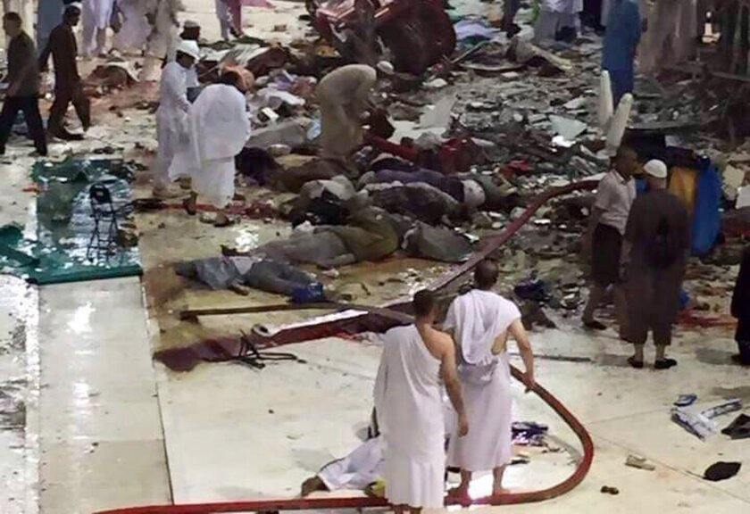 File -- In this Sept. 11, 2015 file photo, pilgrims and first responders gather at the site of a crane collapse that killed dozens inside the Grand Mosque in Mecca, Saudi Arabia. A state-linked Saudi newspaper reported Tuesday, July 12, 2016 that charges, followed by a trial, are due soon over the