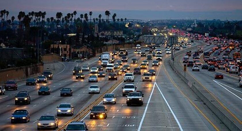 The 110 Freeway south of downtown on a busy evening. State legislators are moving to allow lone motorists use carpool lanes on congested stretches of the 110 and 10 freeways for a fee.