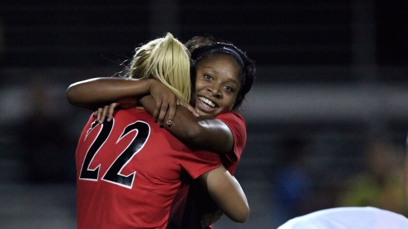 Aztec midfielder #3 (right) Milan Moses congratulates forward #22 Leah Pruitt after scoring against the Toreros Thursday. SDSU beat USD 3-4 Thursday.