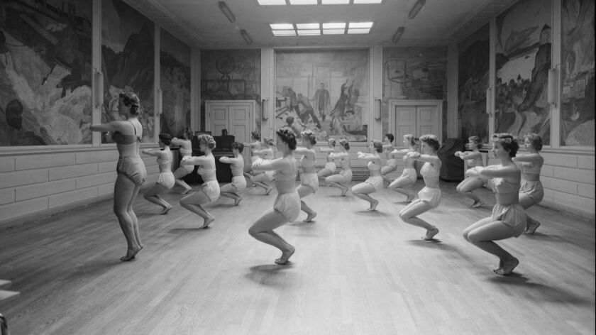 """A photograph featured in """"Sun Seekers: The Cure of California"""" of pupils exercising at the Mensendie"""