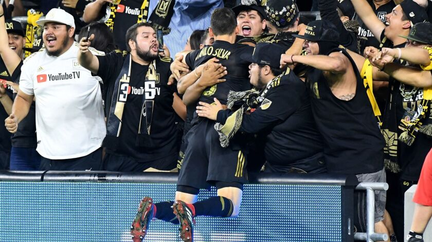 LAFC's Danilo Silva celebrates with fans after scoring in an MLS knockout-round playoff match against Real Salt Lake at Banc of California Stadium on Nov. 1. LAFC lost 3-2.