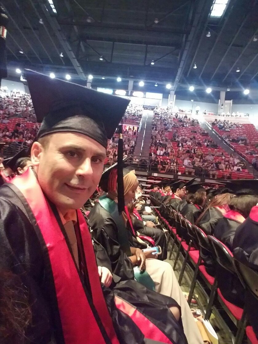 In this May 2016 photo released by a family member shows Robin Shahini during his International Security and Conflict Resolution San Diego State University graduation ceremony in San Diego, Calif. The U.S. State Department said Thursday, July 21, 2016, that it is looking into reports another Americ