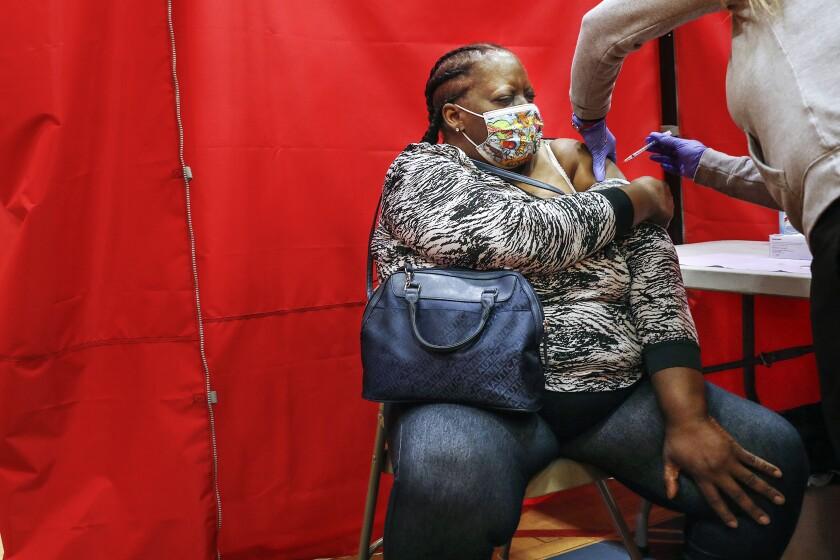A woman receives a COVID-19 vaccine.