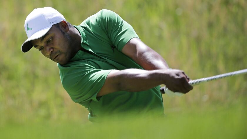 Harold Varner III drives off the fourth tee during the third round of the PGA Championship golf tour
