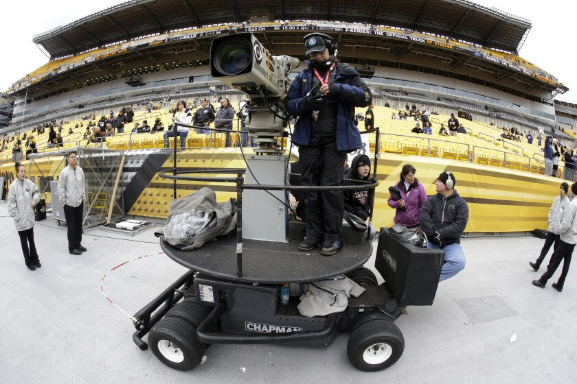 A CBS camera operator prepares to cover a Pittsburgh Steelers-Buffalo Bills game in Pittsburgh on Nov. 10, 2013.