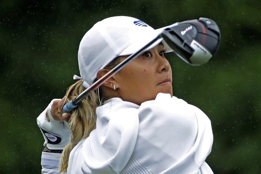 Danielle Kang follows through on her drive on the fourth hole during the third and final round of the LPGA Drive On Championship golf tournament Sunday, Aug. 2, 2020, at Inverness Golf Club in Toledo, Ohio. (AP Photo/Gene J. Puskar)