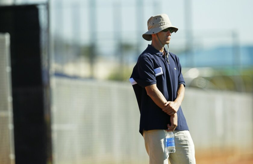 San Diego Padres general manager A. J. Preller looks on during a spring training practice.