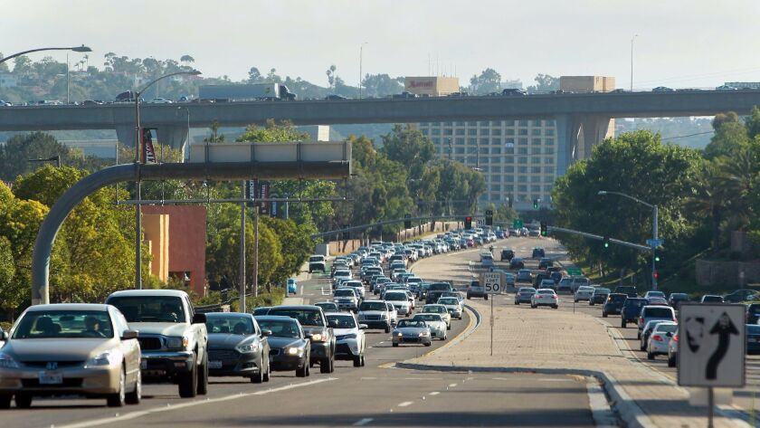 Congested traffic on Friars Road, with the Interstate 805 overpass in the background