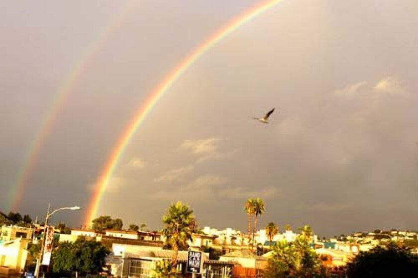 The rainbows are seen from the La Jolla Light's office on Pearl Street. Photo: Daniel K. Lew
