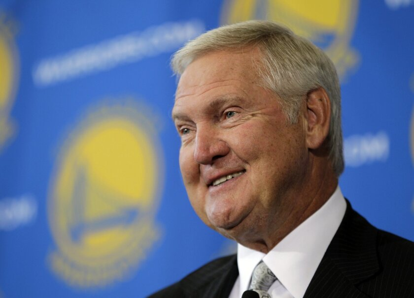 FILE - In this May 24, 2011, file photo, Jerry West, a new member of the Golden State Warriors basketball club's Executive Board, smiles during an NBA basketball  news conference in San Francisco. West has mounted an impassioned defense of LeBron James, saying those who criticize the Cleveland Cava