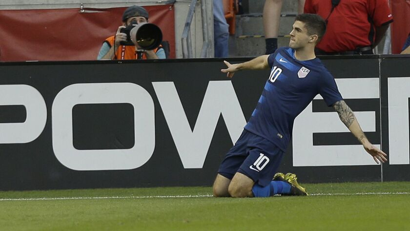 United States' Christian Pulisic celebrates after scoring during the first half against Chile on Tuesday in Houston.
