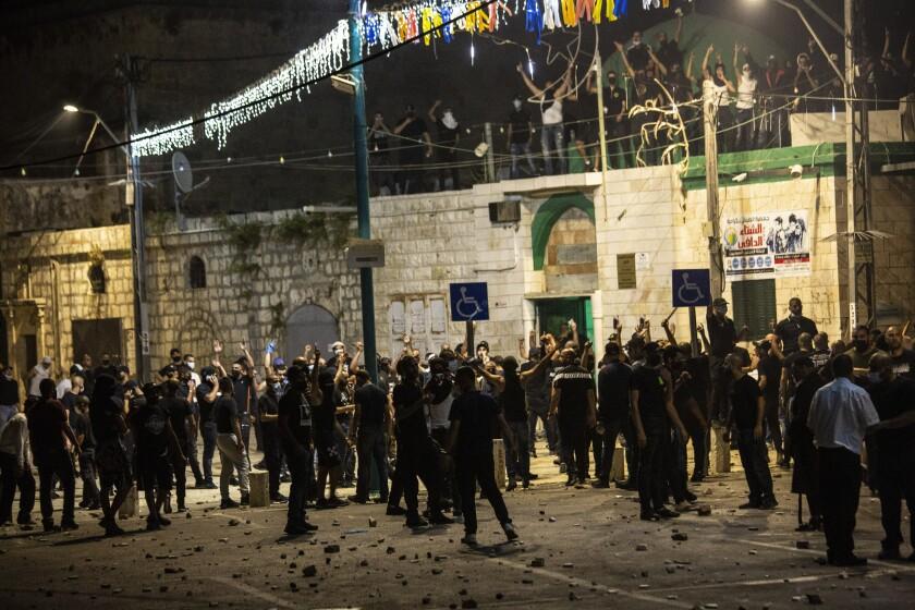 Israeli Arabs gather outside a mosque