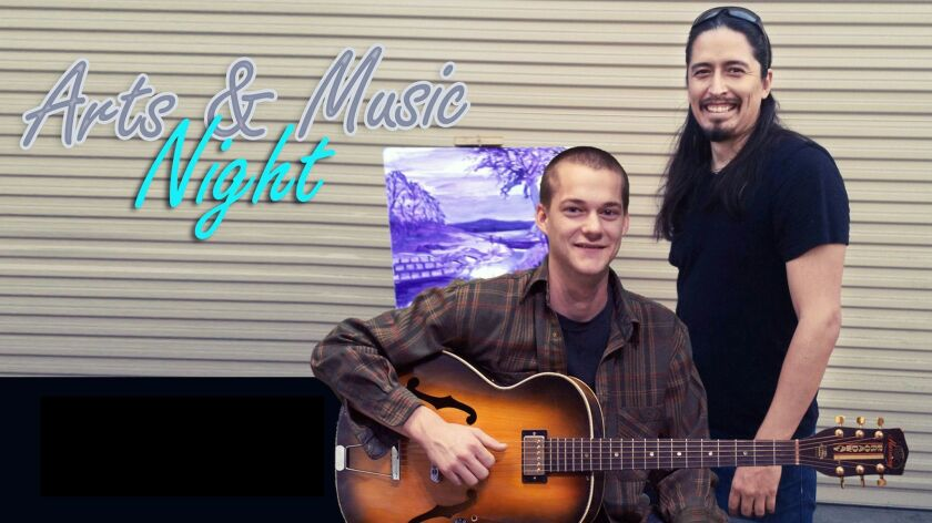Joshua Correa, right, organizes arts and music nights at the Bridges at Kraemer Place homeless shelt