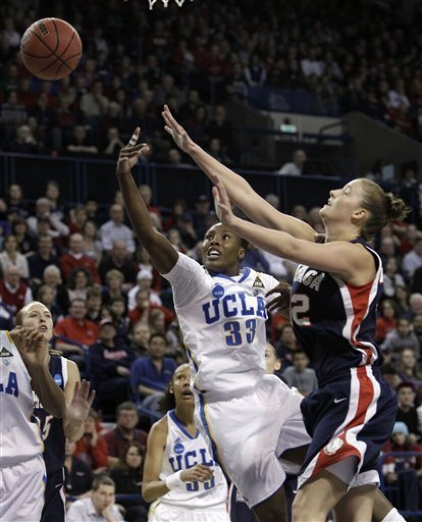 UCLA's Jasmine Dixon (33) gets a shot off in front of Gonzaga's Kayla Standish during the first half of their second-round game of the NCAA women's college basketball tournament Monday, March 21, 2011, in Spokane, Wash. (AP Photo/Elaine Thompson)