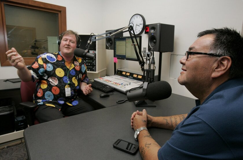 Tribal Chairman Robert Smith (right) is interviewed Tuesday by John Fox at Pala's new radio station.