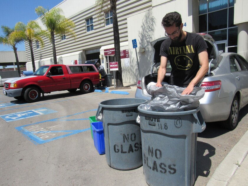 Raed Sinnawi of La Mesa recycles at the EDCO waste and recycling facility in this file photo. EDCO is proposing a rate hike.