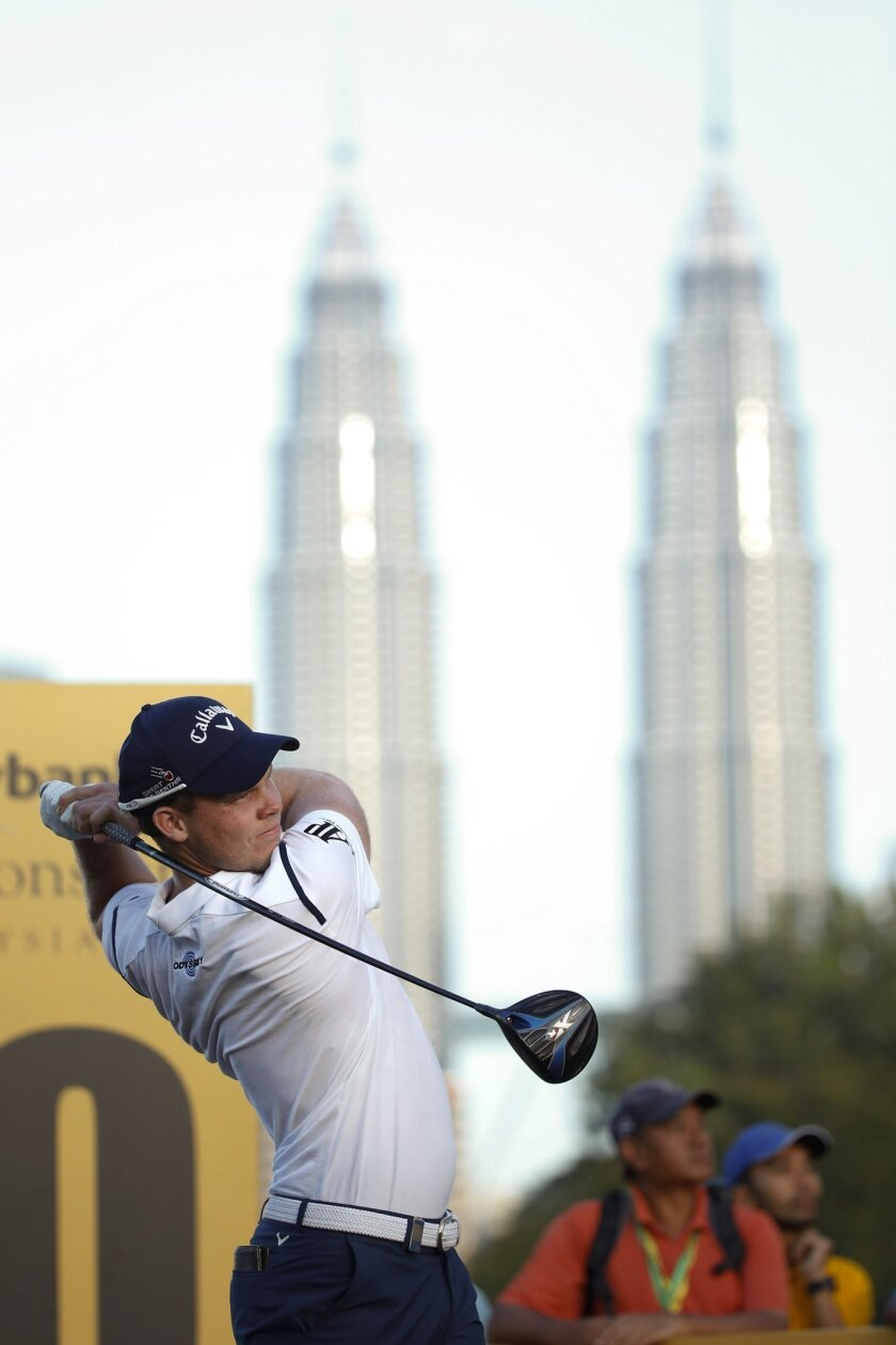 Danny Willet of Britain hits a shot during day two of the Maybank Championship golf tournament in Kuala Lumpur, Malaysia, Friday, Feb. 19, 2016. (AP Photo/Vincent Thian)