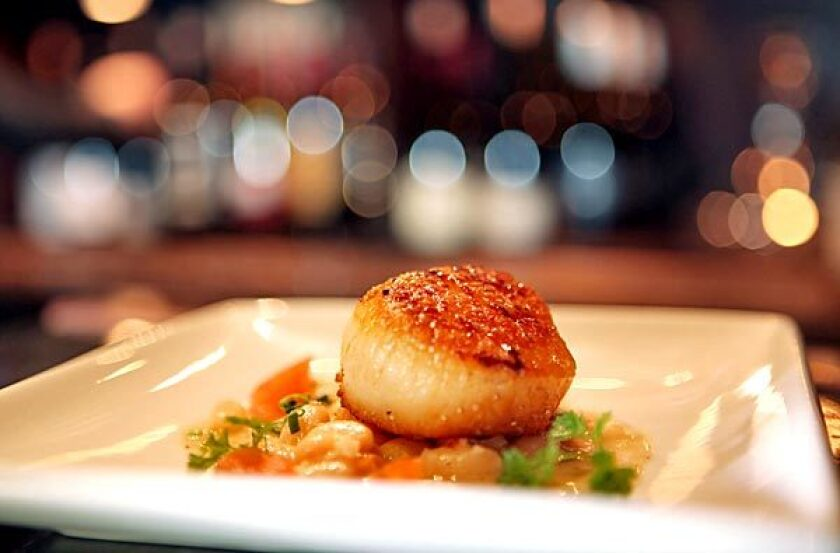 The Sunday supper menu at Noir Food & Wine has included scallop.