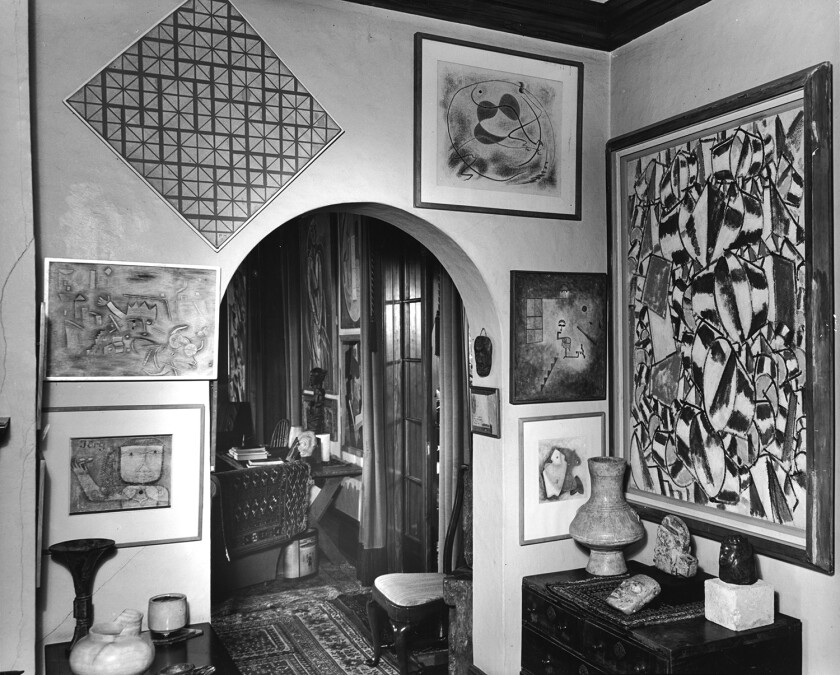 A small Surrealist abstraction by L.A. artist Knud Merrild is above a chest in the corner of the Arensbergs' dining room.