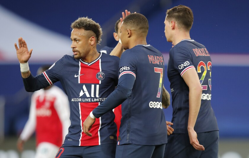 PSG's Kylian Mbappe, centre, celebrates after he scores his sides second goal with PSG's Neymar, left, and PSG's Julian Draxler, right, during the French League One soccer match between Paris Saint-Germain and Reims at the Parc des Princes stadium in Paris, France, Sunday, May 16, 2021. (AP Photo/Michel Euler)