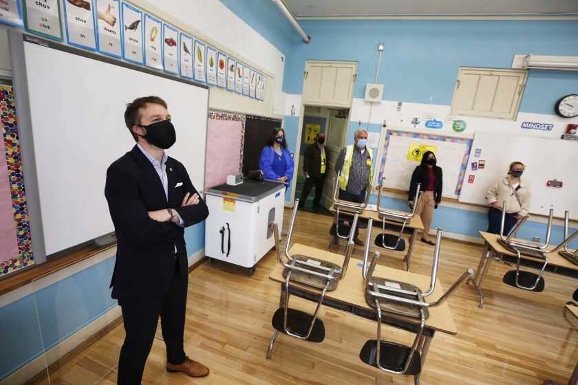 School officials check out empty classroom for reopening.