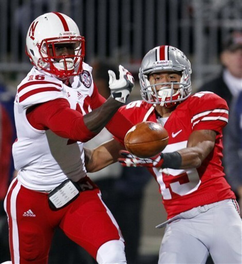 Nebraska cornerback Stanley Jean-Baptiste (16) breaks up a pass intended for Ohio State wide receiver Devin Smith (15) in the second half of an NCAA college football game, Saturday, Oct. 6, 2012, in Columbus, Ohio. (AP Photo/Tony Dejak)