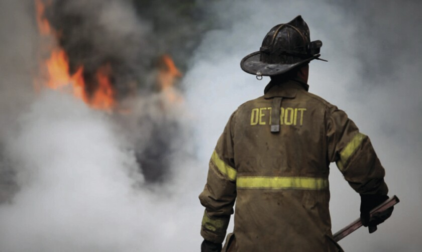 """A firefighter prepares to head into a fire in """"Burn."""""""