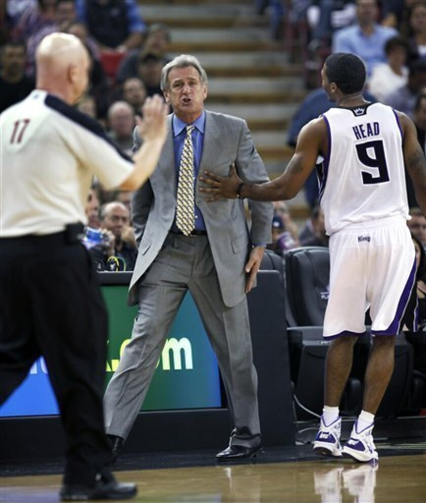 Sacramento Kings guard Luther Head, right, holds back coach Paul Westphal after Westphal was called for a technical foul during the first half of an NBA basketball game against the Toronto Raptors in Sacramento, Calif., Monday, Nov. 1, 2010. (AP Photo/Steve Yeater)